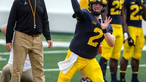 <p>               Michigan quarterback Shea Patterson (2) throws a pass while watched by head coach Jim Harbaugh, left, during a preseason open practice session by the NCAA college football team at Michigan Stadium in Ann Arbor, Mich., Sunday, Aug. 26, 2018. Patterson is a transfer from Mississippi and has been named the starter by Harbaugh. (AP Photo/Tony Ding)             </p>