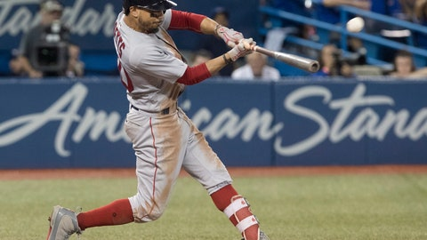 <p>               Boston Red Sox's Mookie Betts hits a home run against the Toronto Blue Jays during the ninth inning of a baseball game Thursday, Aug. 9, 2018, in Toronto. (Fred Thornhill/The Canadian Press via AP)             </p>
