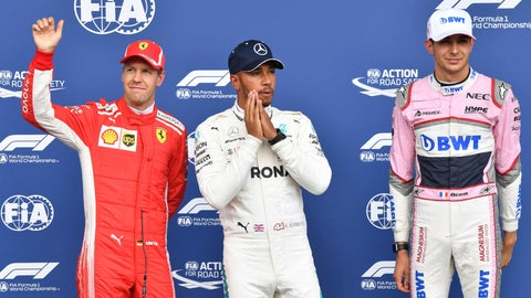 <p>               Mercedes driver Lewis Hamilton of Britain, center, who won pole position, poses with Ferrari driver Sebastian Vettel of Germany, left, who placed second and Force India driver Esteban Ocon of France, who placed third at the qualifying session of the Belgian Formula One Grand Prix in Spa-Francorchamps, Belgium, Saturday, Aug. 25, 2018. The Belgian Formula One Grand Prix will take place on Sunday, Aug. 26, 2018. (AP Photo/Geert Vanden Wijngaert)             </p>