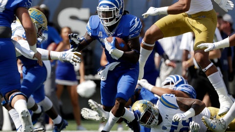 <p>               FILE -- In this Sept. 16, 2017 file photo, Memphis running back Darrell Henderson (8) runs against UCLA in an NCAA college football game in Memphis, Tenn. Despite losing several experienced starters, Memphis still has experience in the backfield with the return of Henderson, who rushed for 1,154 yards and nine touchdowns last season. (AP Photo/Mark Humphrey, File)             </p>