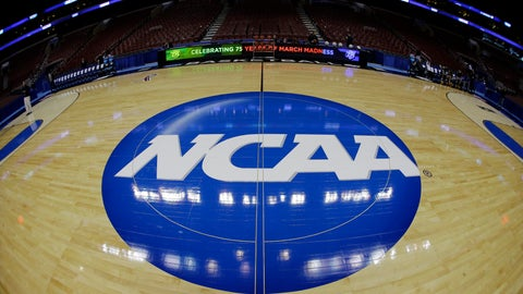 <p>               FILE - In this March 21, 2013, file photo, taken with a fisheye lens, the NCAA logo is displayed on the court during the NCAA college basketball tournament in Philadelphia. College basketball players who go undrafted by the NBA will be allowed to return to school and play as part of sweeping NCAA reforms in the wake of a corruption scandal, the NCAA announced Wednesday, Aug. 8, 2018. (AP Photo/Matt Slocum, File)             </p>