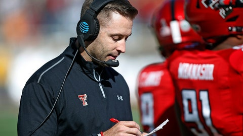 <p>               FILE - In this Nov. 18, 2017, file photo, Texas Tech coach Kliff Kingsbury looks down at his notes during the second half of the team's NCAA college football game TCU in Lubbock, Texas. With David Gibbs going into his fourth season as defensive coordinator, and the defense greatly improved in that time, Kingsbury can put more attention into the quarterback situation. The defense could also take some pressure off of the offense. (AP Photo/Brad Tollefson, File)             </p>
