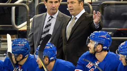 <p>               FILE - In this Sept. 19, 2016, file photo, New York Rangers associate coach Scott Arniel, left, and head coach Alain Vigneault talks in the first period of a preseason NHL hockey game in New York. The Washington Capitals have hired Scott Arniel and Reid Cashman as assistants on coach Todd Reirden's staff. General manager Brian MacLellan announced the moves Monday, Aug. 6, 2018. After Reirden was promoted from associate coach to fill Barry Trotz's role, Arniel and Cashman replace him and outgoing assistant Lane Lambert behind the bench for the defending Stanley Cup champions. Arniel, 55, spent the past five seasons as associate coach for the New York Rangers under Alain Vigneault. (AP Photo/Kathy Kmonicek, File)             </p>