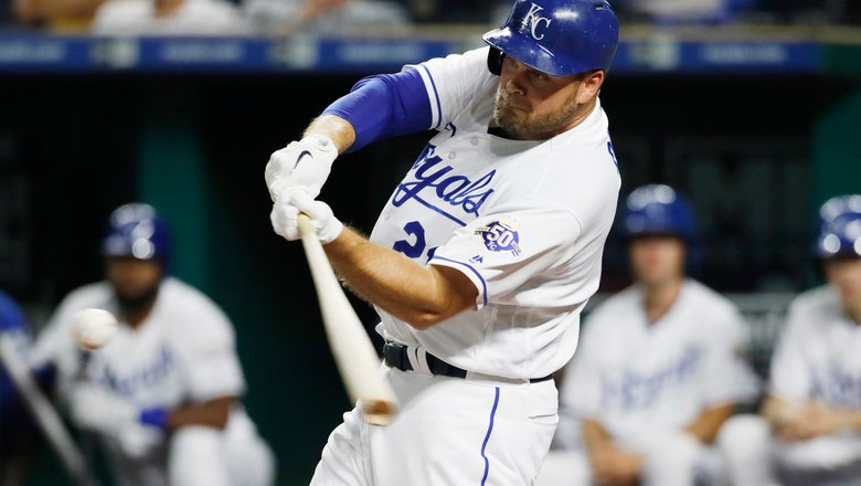 Royals beat Blue Jays 6-2 after long delay to split series