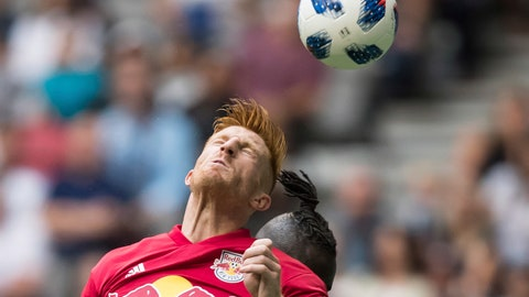 <p>               New York Red Bulls' Tim Parker gets his head on the ball to prevent a pass from reaching Vancouver Whitecaps' Kei Kamara, back, during the second half of an MLS soccer game Saturday, Aug. 18, 2018 in Vancouver, British Columbia. (Darryl Dyck/The Canadian Press via AP)             </p>