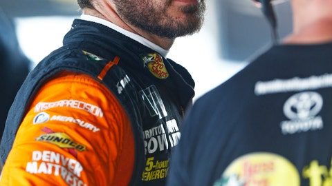 <p>               Martin Truex talks with a crew member during practice for a NASCAR Cup Series auto race, Friday, Aug. 17, 2018, in Bristol, Tenn. (AP Photo/Wade Payne)             </p>