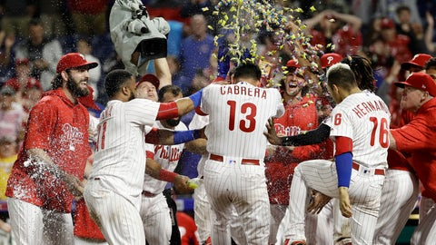 <p>               Philadelphia Phillies' Asdrubal Cabrera (13) is mobbed by his teammates after hitting the game-winning home run off Chicago Cubs relief pitcher Steve Cishek during the 10th inning of a baseball game Friday, Aug. 31, 2018, in Philadelphia. Philadelphia won 2-1. (AP Photo/Matt Slocum)             </p>