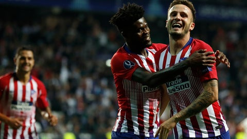 <p>               Atletico's Saul Niguez, right, celebrates after scoring his side's third goal during the UEFA Super Cup final soccer match between Real Madrid and Atletico Madrid at the Lillekula stadium in Tallinn, Estonia, Wednesday, Aug. 15, 2018. (AP Photo/Mindaugas Kulbis)             </p>