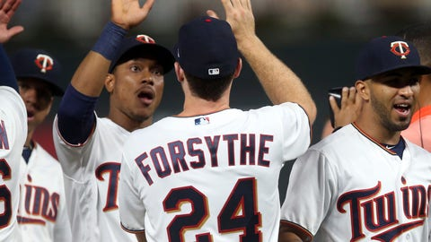 <p>               Minnesota Twins' Jorge Polanco, left, congratulates Logan Forsythe as they and Eddie Rosario, right, go through the celebration line after the Twins defeated the Detroit Tigers 15-8 in a baseball game Thursday, Aug. 16, 2018, in Minneapolis. Polanco had four RBIs and Forsythe went 5-for-5 at the plate. (AP Photo/Jim Mone)             </p>