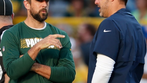 <p>               Green Bay Packers' Aaron Rodgers talks to Tennessee Titans head coach Mike Vrabel before a preseason NFL football game Thursday, Aug. 9, 2018, in Green Bay, Wis. (AP Photo/Matt Ludtke)             </p>