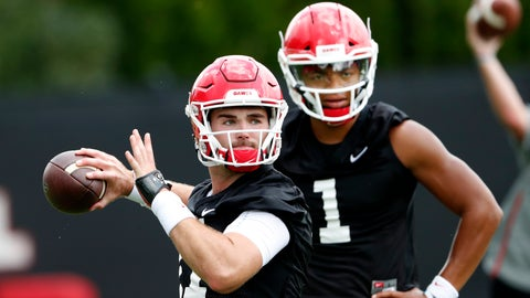 <p>               In this Friday, Aug. 3, 2018, file photo Georgia quarterback Jake Fromm (11) throws a pass as freshman quarterback Justin Fields (1) looks on during their NCAA college football training camp practice in Athens, Ga. It will be difficult for Fromm to top his 2017 freshman season as Georgia's starting quarterback after winning at Notre Dame, winning in the Rose Bowl and taking the Bulldogs to their first SEC championship since 2005. Fromm's first challenge for 2018 is just to keep his starting job over top recruit Fields. (AP Photo/John Bazemore, File)             </p>
