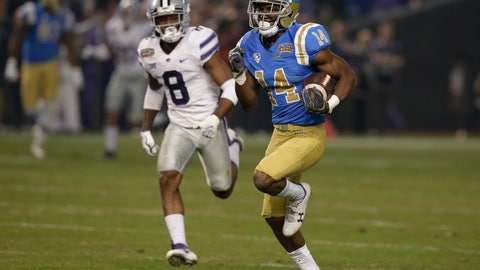 <p>               FILE - In this Dec. 26, 2017, file photo, UCLA wide receiver Theo Howard (14) runs away from Kansas State defensive back Duke Shelley for a touchdown during the Cactus Bowl NCAA college football game in Phoenix. Howard is among several returning Bruins veterans who hope to return the program to Pac-12 title contention in their first year under new coach Chip Kelly. (AP Photo/Rick Scuteri, File)             </p>