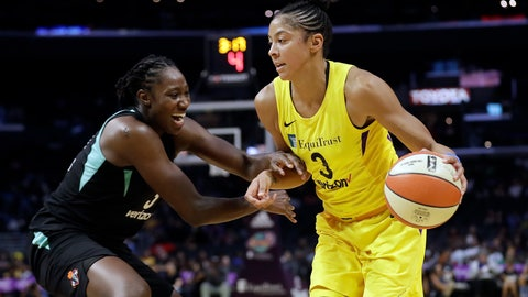 <p>               Los Angeles Sparks' Candace Parker, right, is defended by New York Liberty's Tina Charles during the first half of a WNBA basketball game Tuesday, Aug. 14, 2018, in Los Angeles. (AP Photo/Marcio Jose Sanchez)             </p>