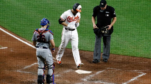 <p>               Baltimore Orioles' Chris Davis, center, crosses home plate in front of New York Mets catcher Kevin Plawecki, left, and umpire Jeff Nelson after rounding the bases on a solo home run in the seventh inning of a baseball game, Tuesday, Aug. 14, 2018, in Baltimore. (AP Photo/Patrick Semansky)             </p>
