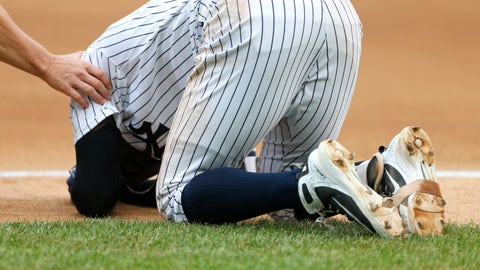 <p>               New York Yankees' Didi Gregorius goes down after a collision with Toronto Blue Jays first baseman Kendrys Morales in the first inning of a baseball game against the Toronto Blue Jays in New York, Sunday, Aug. 19, 2018. (AP Photo/Noah K. Murray)             </p>