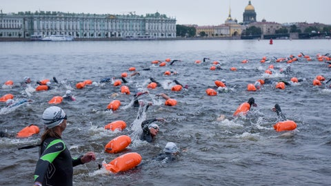 <p>               People swim after the mass start in the Neva River in St.Petersburg, Russia, Sunday, Aug. 12, 2018. More than 600 swimmers from 13 countries have swum their way through one of Russia's most scenic and historic settings, circling the St. Petersburg island that holds the Peter and Paul Fortress. (AP Photo/Alexander Belenky)             </p>