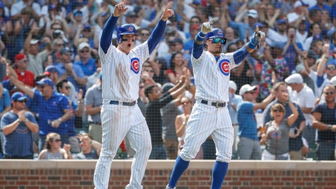 <p>               Chicago Cubs' Anthony Rizzo, left, and Javier Baez, right, celebrate after scoring on single hit by Jason Heyward against the Washington Nationals during the sixth inning of a baseball game, Friday, Aug. 10, 2018, in Chicago. (AP Photo/Kamil Krzaczynski)             </p>