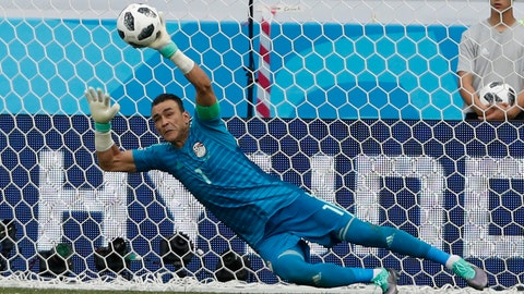 <p>               FILE - In this file photo dated Monday, June 25, 2018, Egypt goalkeeper Essam El Hadary deflects a penalty during the group A match between Saudi Arabia and Egypt at the 2018 soccer World Cup at the Volgograd Arena in Volgograd, Russia.  In a social media announcement, the 45-year old Egypt goalkeeper Essam El Hadary said he is retiring from the national team after becoming the oldest man to play in a World Cup match. (AP Photo/Darko Vojinovic, FILE)             </p>