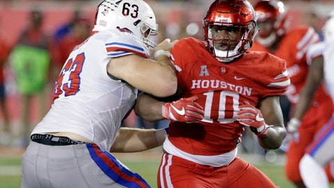 <p>               FILE - In this Oct. 7, 2017, file photo, SMU offensive lineman Evan Brown (63) blocks Houston defensive tackle Ed Oliver (10) during an NCAA college football game in Houston.  At 6-foot-3 and 290, Oliver combines power, quickness and rare sideline-to-sideline speed for an interior lineman. Houston will push him as a Heisman Trophy contender, but he is more likely to be the first pick in next year's draft. (AP Photo/Michael Wyke, File)             </p>