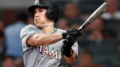 <p>               Miami Marlins' J.T. Realmuto follows through on two-run base hit in the fourth inning of a baseball game against the Atlanta Braves Tuesday, Aug. 14, 2018 in Atlanta. (AP Photo/John Bazemore)             </p>