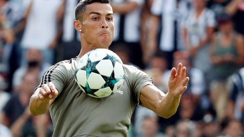 <p>               Cristiano Ronaldo controls the ball during a friendly match between the Juventus A and B teams, in Villar Perosa, northern Italy, Sunday, Aug.12, 2018. (AP Photo/Antonio Calanni)             </p>