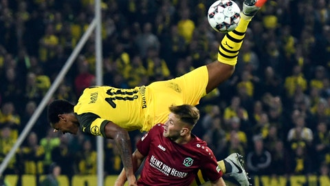 <p>               Borussia Dortmund's Manuel Akanji, top, flies over Hannover 96's Niclas Fullkrug as they fight for the ball during a German soccer match Friday, Aug. 31, 2018, in Hannover, Germany. (Peter Steffen/dpa via AP)             </p>