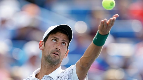 <p>               Novak Djokovic, of Serbia, serves to Roger Federer, of Switzerland, during the finals at the Western & Southern Open tennis tournament, Sunday, Aug. 19, 2018, in Mason, Ohio. (AP Photo/John Minchillo)             </p>