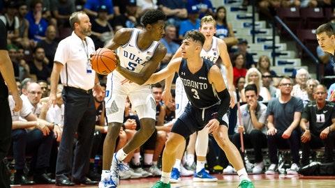 <p>               Duke's R.J. Barrett (5) goes up against Toronto's Inaki Alvarez (3) during a college basketball exhibition game in Mississauga, Ontario, Friday, Aug. 17, 2018. (Christopher Katsarov/The Canadian Press via AP)             </p>