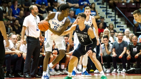 <p>               Duke's R.J. Barrett (5) goes up against Toronto's Inaki Alvarez (3) during a college basketball exhibition game in Mississauga, Ontario, Friday, Aug. 17, 2018. (Christopher Katsarov/The Canadian Press via AP)             </p>