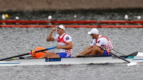 <p>               Martin Sinkovic, right, and Valent Sinkovic of Croatia react after winning the Men's Pair race final at the European Rowing Championships in Glasgow, Scotland, Saturday, Aug. 4, 2018. (AP Photo/Darko Bandic)             </p>