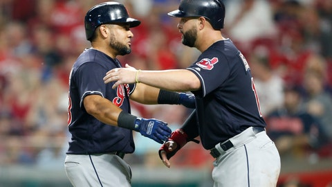 <p>               Cleveland Indians' Melky Cabrera, left, gets a hug from Yonder Alonso following Cabrera's a two-run home run off Cincinnati Reds relief pitcher Cody Reed during the sixth inning of a baseball game Wednesday, Aug. 15, 2018, in Cincinnati. (AP Photo/Gary Landers)             </p>