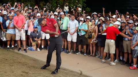 <p>               Tiger Woods hits to the ninth green during the final round of the PGA Championship golf tournament at Bellerive Country Club, Sunday, Aug. 12, 2018, in St. Louis. (AP Photo/Brynn Anderson)             </p>