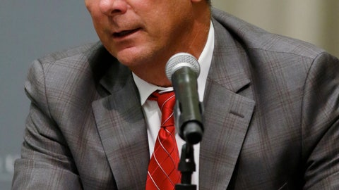 <p>               Ohio State football coach Urban Meyer answers questions during a news conference in Columbus, Ohio, Wednesday, Aug. 22, 2018. Ohio State suspended Meyer on Wednesday for three games for mishandling domestic violence accusations, punishing one of the sport's most prominent leaders for keeping an assistant on staff for several years after the coach's wife accused him of abuse. Athletic director Gene Smith was suspended from Aug. 31 through Sept. 16.  (AP Photo/Paul Vernon)             </p>