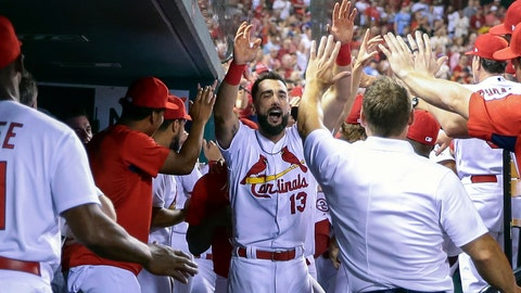 <p>               St. Louis Cardinals' Matt Carpenter, center, celebrates with teammates in the dugout after hitting a two-run home run during the second inning of a baseball game against the Cincinnati Reds, Friday, Aug. 31, 2018, in St. Louis. (AP Photo/Tim Spyers)             </p>