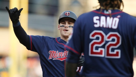 <p>               Minnesota Twins designated hitter Tyler Austin, left, approaches home plate after hitting a two-run home run that also scored Miguel Sano (22) during the fifth inning of a baseball game against the Detroit Tigers, Saturday, Aug. 11, 2018, in Detroit. (AP Photo/Carlos Osorio)             </p>