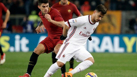 """<p>               FILE- in this. Sunday, Feb. 25, 2018 file photo, AC Milan's Suso, right, and Roma's Diego Perotti vie for the ball during a Serie A soccer match between Roma and AC Milan, at the Rome Olympic stadium. A """"Made in USA"""" matchup. The """"American derby."""" Italian media are promoting Friday's match between AC Milan and Roma at the San Siro stadium as the first meeting of two American-owned clubs in Serie A. (AP Photo/Alessandra Tarantino, File)             </p>"""