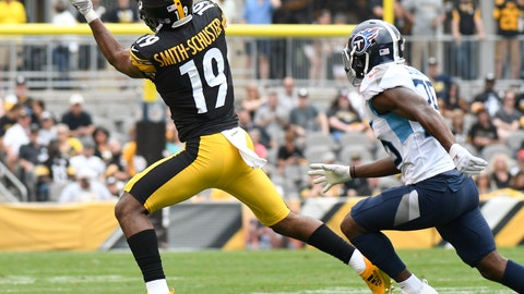 <p>               Pittsburgh Steelers wide receiver JuJu Smith-Schuster (19) makes a catch as Tennessee Titans cornerback Adoree' Jackson (25) defends in the first half of an NFL football game, Saturday, Aug. 25, 2018, in Pittsburgh. (AP Photo/Don Wright)             </p>