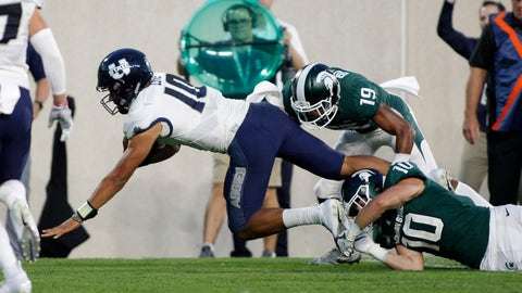 <p>               Utah State quarterback Jordan Love, left, is tripped by Michigan State's Matt Morrissey (10) and Josh Butler (19) during the second quarter of an NCAA college football game, Friday, Aug. 31, 2018, in East Lansing, Mich. (AP Photo/Al Goldis)             </p>
