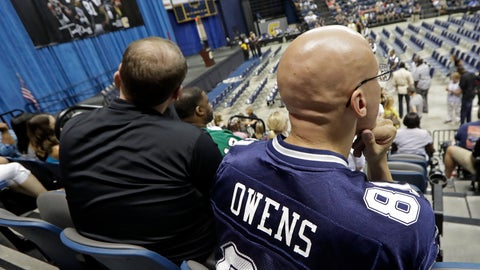 <p>               Reyad Rasul, of Columbus, Ohio, right, wears a Terrell Owens jersey as he waits for the former wide receiver to deliver his NFL Pro Football Hall of Fame speech on Saturday, Aug. 4, 2018, in Chattanooga, Tenn. Rasul was planning on going to Canton, Ohio, to see the Hall of Fame festivities in person, but changed his plans when Owens decided to celebrate his induction at the University of Tennessee at Chattanooga, where he played football and basketball and ran track. (AP Photo/Mark Humphrey)             </p>