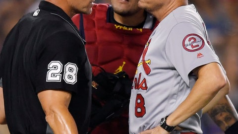 <p>               St. Louis Cardinals interim manager Mike Shildt, right, argues a foul ball call with home plate umpire Jim Wolf, along with catcher Yadier Molina during a baseball game Tuesday, Aug. 21, 2018, in Los Angeles. The Cardinals are baseball's hottest team in the dog days of summer. They're a major league-best 17-4 in August and have won eight in a row on the road while gaining ground in the division and wild-card races. The results have come since firing manager Mike Matheny last month. (AP Photo/Mark J. Terrill)             </p>