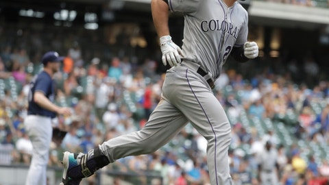 <p>               Colorado Rockies' Nolan Arenado hits a home run during the 11th inning of a baseball game against the Milwaukee Brewers Sunday, Aug. 5, 2018, in Milwaukee. (AP Photo/Morry Gash)             </p>