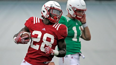 "<p>               FILE - In this Aug. 8, 2018, file photo, Nebraska running back Maurice Washington (28) carries the ball during NCAA college football fall practice in Lincoln, Neb. Washington qualified academically just a few days before the start of preseason practice but has performed well enough already that Nebraska coach Scott Frost has said ""he's going to be a pretty special player."" ""He's definitely opening some eyes,"" Frost said. ""I think he's got a bright future here."" (AP Photo/Nati Harnik, File)             </p>"