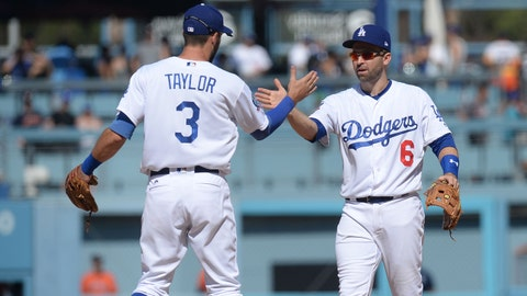 August 5, 2018; Los Angeles, CA, USA; Los Angeles Dodgers shortstop Chris Taylor (3) celebrates with second baseman Brian Dozier (6) following the 3-2 victory against the Houston Astros at Dodger Stadium. Mandatory Credit: Gary A. Vasquez-USA TODAY Sports