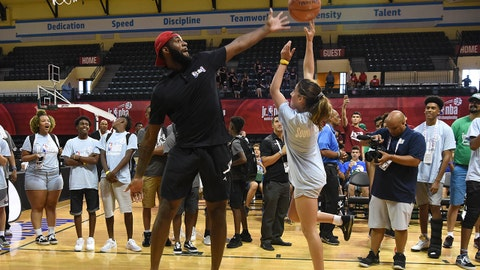 ORLANDO, FL - AUGUST 05:  Andre Drummond #0 of the Detroit Pistons blocks a shot of a tournament participant at the Tip-Off Ceremony during the Jr. NBA World Championships at ESPN Wide World of Sports on August 5, 2018 in Orlando, Florida. NOTE TO USER: User expressly acknowledges and agrees that, by downloading and/or using this photograph, user is consenting to the terms and conditions of the Getty Images License Agreement. Mandatory Copyright Notice: Copyright 2018 NBAE (Photo by Pamela Costello/NBAE via Getty Images)