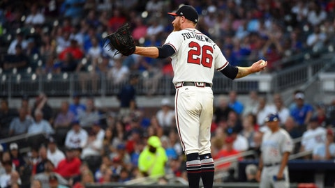 Aug 30, 2018; Atlanta, GA, USA; Atlanta Braves starting pitcher Mike Foltynewicz (26) talks to the umpire after a pitch against the Chicago Cubs during the first inning at SunTrust Park. Mandatory Credit: Adam Hagy -USA TODAY Sports
