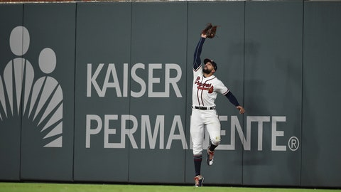 Aug 17, 2018; Atlanta, GA, USA; Atlanta Braves right fielder Nick Markakis (22) makes a catch against the wall against the Colorado Rockies during the eighth inning at SunTrust Park. Mandatory Credit: Adam Hagy-USA TODAY Sports
