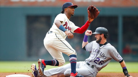 Colorado Rockies David Dahl (26) steals second base as Atlanta Braves second baseman Ozzie Albies receives the throw in the first inning of a baseball game, Sunday, Aug. 19, 2018, in Atlanta. (AP Photo/Todd Kirkland)