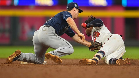 Aug 29, 2018; Atlanta, GA, USA; Tampa Bay Rays lTampa Bay Rays second baseman Joey Wendle (18) tags out Atlanta Braves second baseman Ozzie Albies (1) during the fifth inning at SunTrust Park. Mandatory Credit: Dale Zanine-USA TODAY Sports