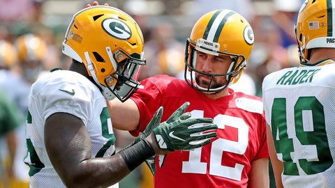 Jul 31, 2018; Ashwaubenon, WI, USA; Green Bay Packers quarterback Aaron Rodgers (12) talks with tight end Emanuel Byrd (86) during Green Bay Packers Training Camp at Ray Nitschke Field.  Mandatory Credit: Jim Matthews/Green Bay Press-Gazette via USA TODAY Sports