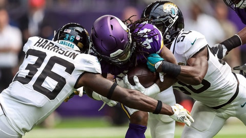 Aug 18, 2018; Minneapolis, MN, USA; Minnesota Vikings running back Mike Boone (44) is tackled by Jacksonville Jaguars safety Ronnie Harrison (36) and linebacker Telvin Smith (50) during the second quarter at U.S. Bank Stadium. Mandatory Credit: Brace Hemmelgarn-USA TODAY Sports